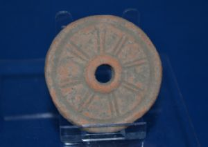 A large and rare redware Roman terracotta wheel from a childs pull along toy chariot, London. SOLD